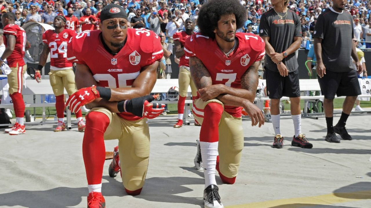 Kaepernick suggests report he would stand during anthem is a lie